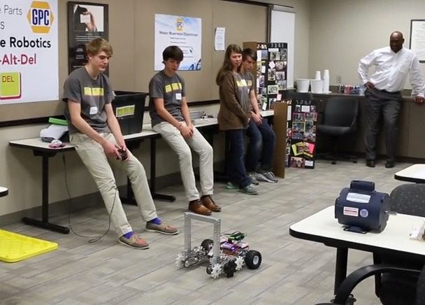 Ctrl-Alt-Del Youth Robotics Team demonstrates their robot for EIS