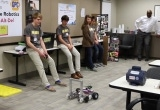 Youth Robotics Team, Ctrl-Alt-Del, gives EIS a demonstration of their robot.