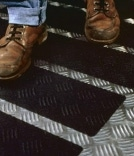 anti-slip boots of person walking